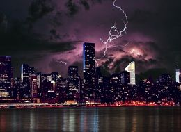 photo of thunderstorm in night city