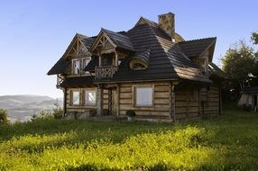 wooden log cottage on top of a mountain