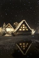 country houses on a snowy night background in Shirakawa