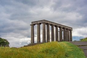 National Monument on a green hill in Scotland