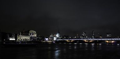 London embankment and bridge across Thames river at Night, uk, england