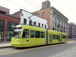 yellow tram in the streets of seattle