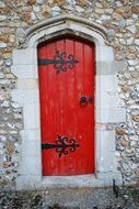 Red door at the entrance of the church