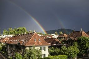rainbow over a village in switzerland