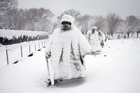 Korean War Veterans Memorial Statues covered with Snow, usa, washington dc