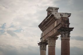cloudy sky over the ruins of a greek temple