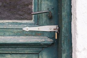 green wood door rusted