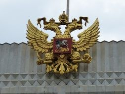 russian coats of arms on the building facade