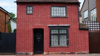 brick house with red walls