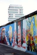 side view of the berlin wall in bright graffiti