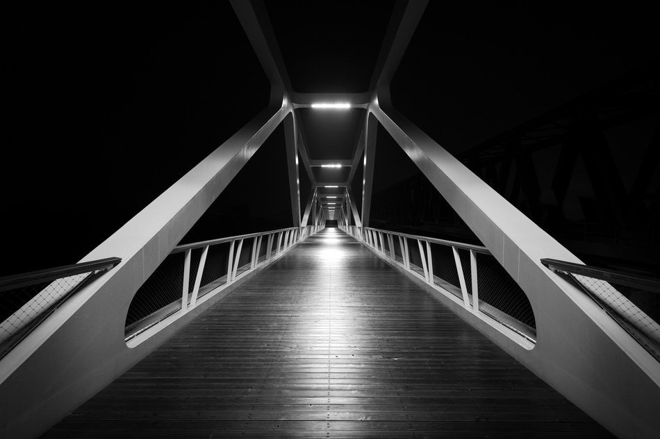 black and white photo of a modern bridge