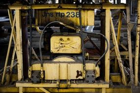 rusty yellow machinery on workplace