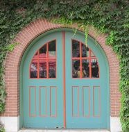 arched door to a brick building
