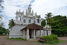 church near trees in india