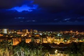 night lights of city at Sea, spain, Canary Islands, Tenerife, puerto de la cruz