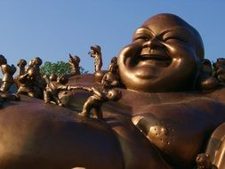 bronze statues of Buddha smile