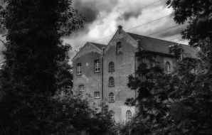 black and white photo of a mystical house