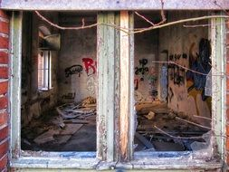 grunge interior of abandoned industrial Building through broken Window