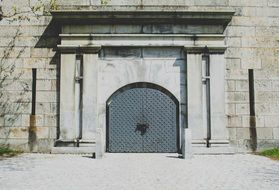 arched double doors to the building