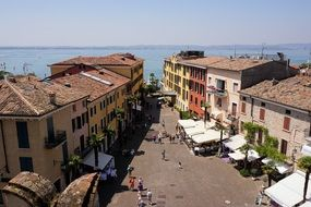panoramic view of a street in the city of sirmione