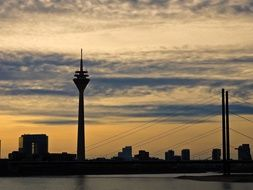 distant view of the tv tower in dusseldorf at sunset