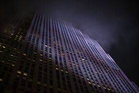 Rockefeller Buildings at foggy night, low angle view, usa, manhattan, nyc