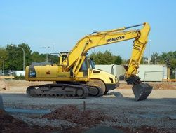 big yellow Excavator stands on ground