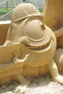 monster sculptures made of sand