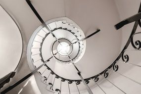 spiral staircase in a white room