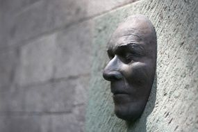 male Face, Sculpture on stone wall, spain, Canary Islands