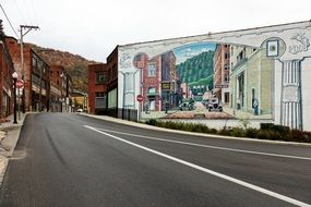 scenic old city, painting on wall of building at road, usa, West Virginia, Welch