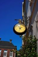 clock on the facade of a building in the old city in Germany