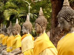 buddha statues stand next to each other