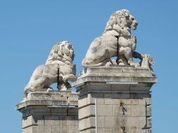 lions on a bridge in arles