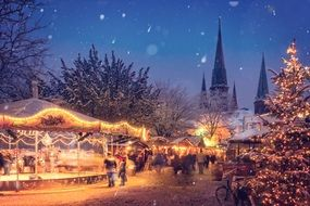 Christmas fair in the lights of garlands