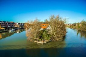 house on an island in the middle of a river in England