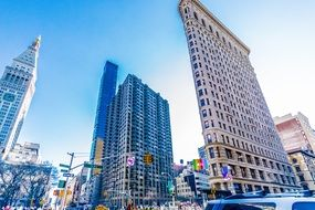 Flatiron building in New York cityscape on a sunny day