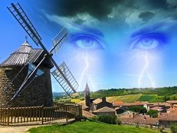 windmill against the sky with eyes