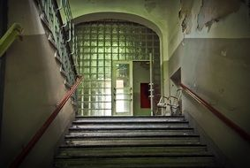 staircase of a ramshackle school