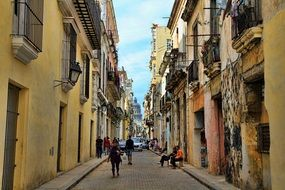 Walking people on alley in Cuba