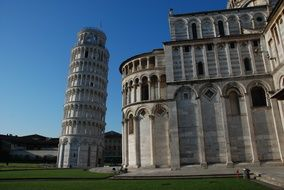 leaning tower near the building in pisa