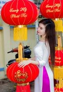 girl stands near chinese lanterns