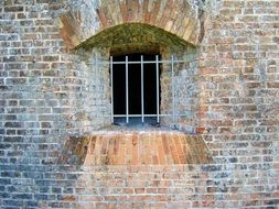 barred window on brick wall