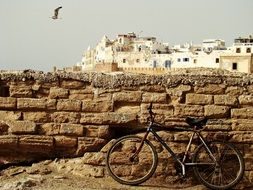 bike is parked in a harbor in Essaouira, Morocco