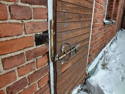 Old Door with Lock in brick wall