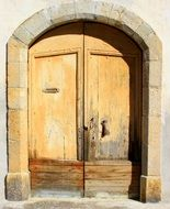 arched front wooden door