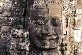 stone face on the wall in Bayon Temple