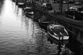 black and white photo of boats on the canal