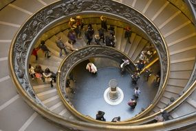 people on a spiral staircase