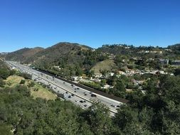 view from a hill on a highway in los angeles